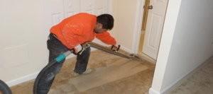 Water Damage Restoration Tech Cleaning Carpet